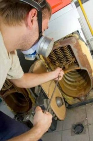 man doing boiler service maintenance
