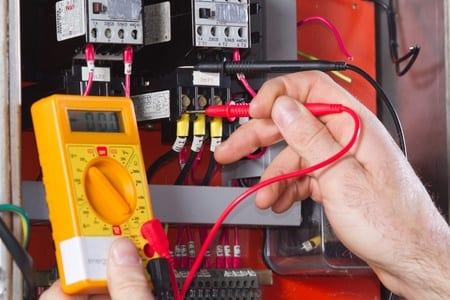 picture of electrician doing electrical testing