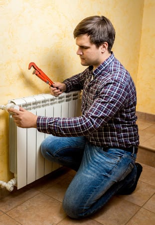 picture of plumber installing radiator